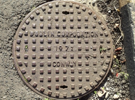 Sometimes I am walking over my own family history. This manhole cover in Dublin Docklands was cast in my grandfather's Iron-foundry at Inchicore where my uncles and father worked for many years, and where I also worked in the school holidays. Judging by the date, I might even have had a hand in making this one!. The foundry is long gone, but hundreds of Conway drains and covers remain on Irish streets, and will for many years to come.