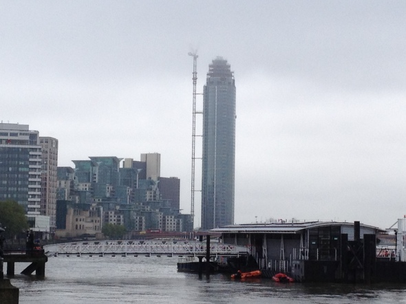 The Tower, One St George Wharf seen from Westminster, with the tip of the crane shrouded in low cloud