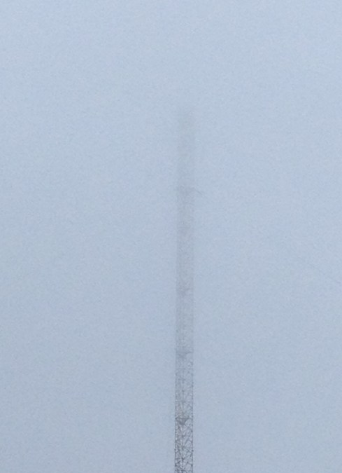 The upper sections vanishing into the mist. It is planned to paint the top 84m of this tower red and white, and to replace the current warning lights with ones of lower intensity.